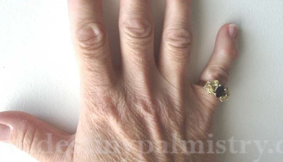 manly hands on a woman, palmistry lessons, bent middle finger, masculine hand on a woman