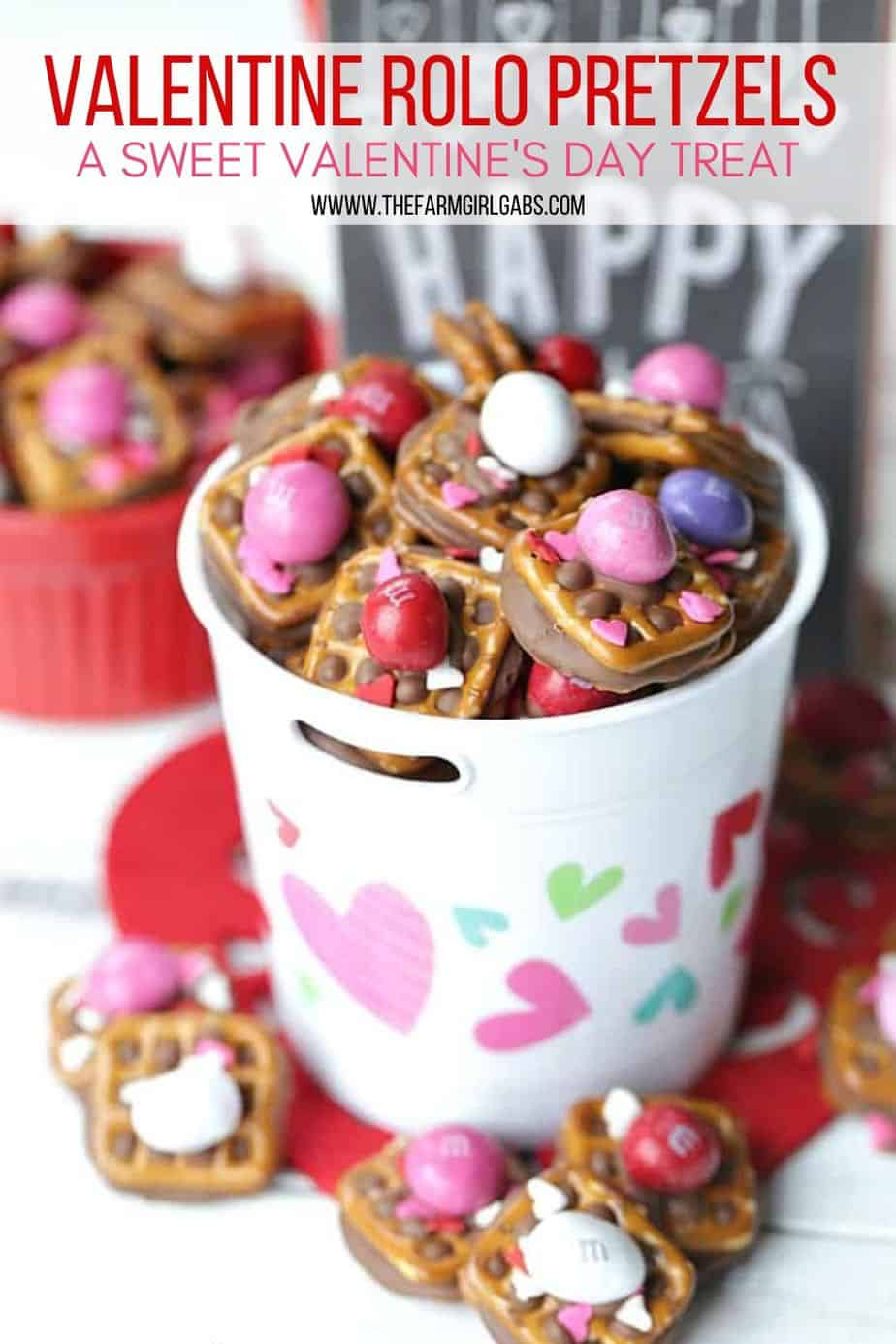 A little bit sweet, a little bit salty and oh so good! These Valentine ROLO Pretzel Sandwiches are a sweet treat for Valentine's Day.  This recipe is an easy Valentine treat to make for class parties, family and friends. They are a huge hit for Valentine's Day. You can change the M&M colors and make these a for Christmas too. They are a huge holiday hit. #rolo #rolopretzels #valentinesdaycandy #valentinesdaytreats #christmastreats #christmascandy