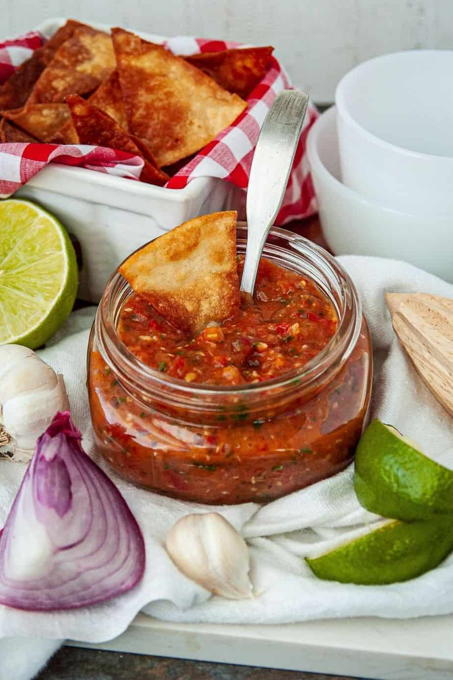 Spice things up with the easy roasted tomato and tomatillo salsa recipe. This easy salsa recipe is full of roasted tomatoes and tomatillos. If you need a side for Mexican night or an easy dip recipe, try this roasted tomato salsa recipe.