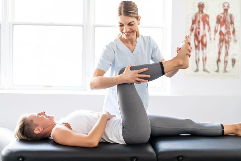 a woman is doing an exercise with her physiotherapist