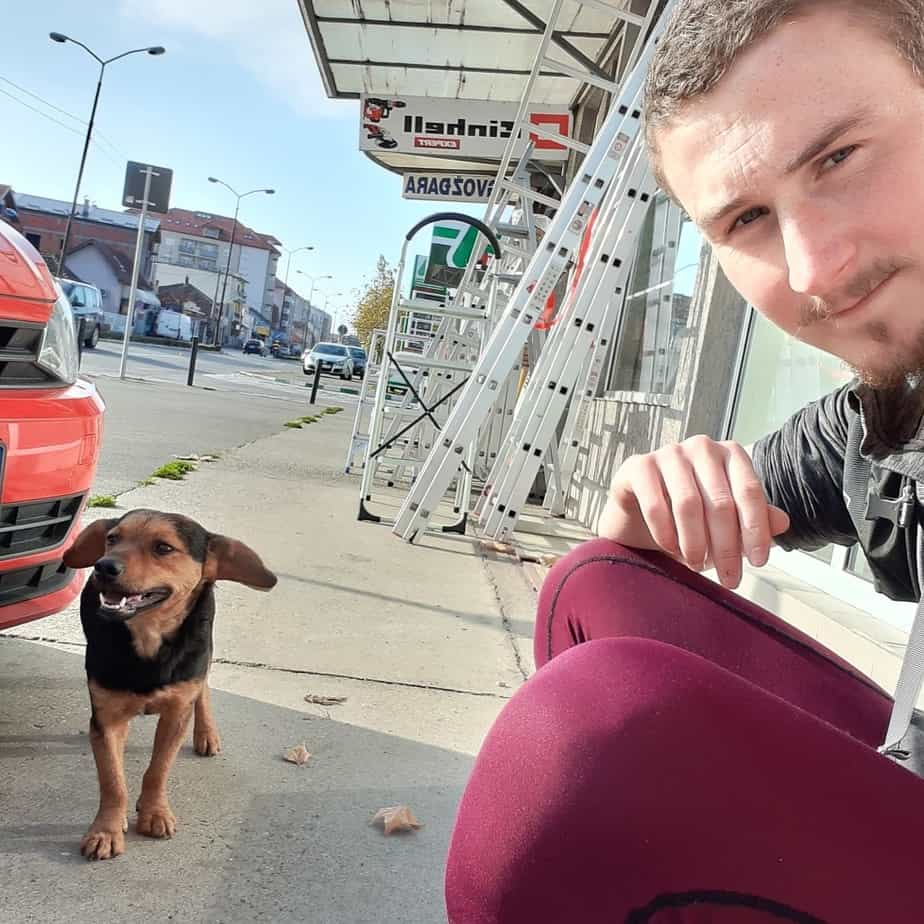 "Dan Atkinson in Serbia with his ""new friend"", who followed him for 10 miles"