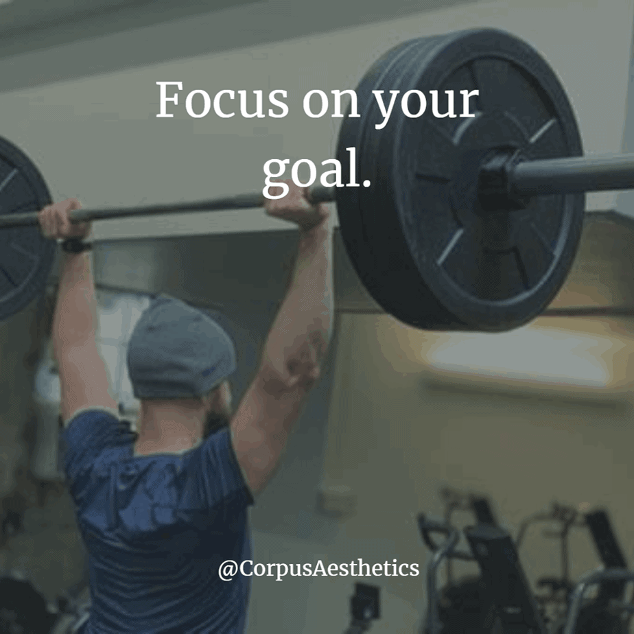gym motivational quotes, focus on your goal, a guy is having a training with weightlifting at the gym