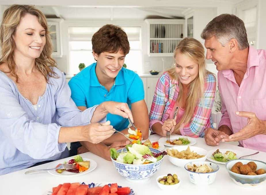 A parents and their children are eating healthy breakfast