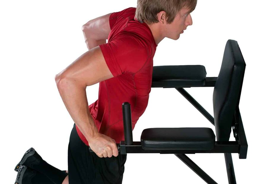 man doing dip exercise on wall mounted dip station