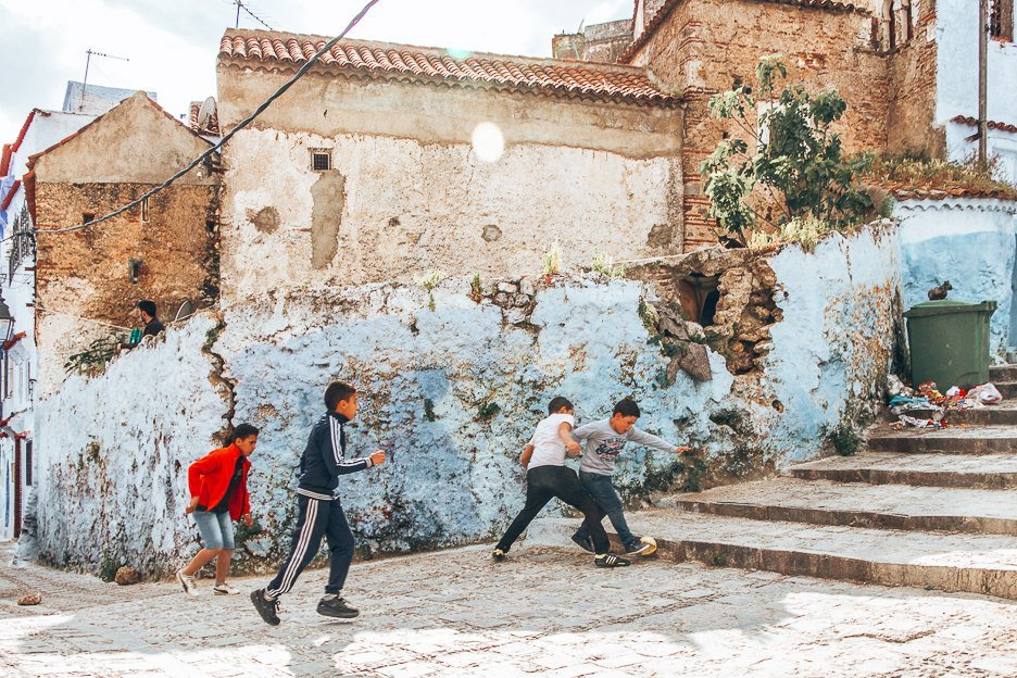 Children play football in the streets of Chefchaouen, Morocco