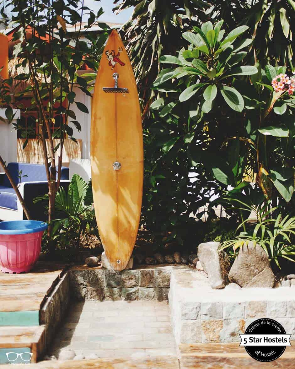 That surfboard? It's the shower next to the pool. That is so cool!