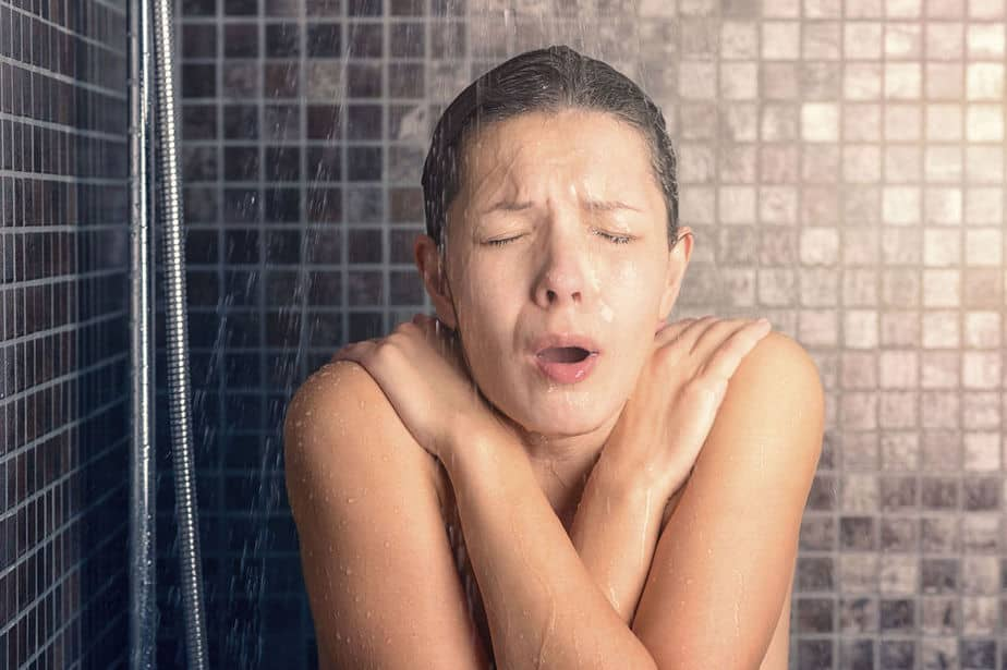 a girl taking a cold shower