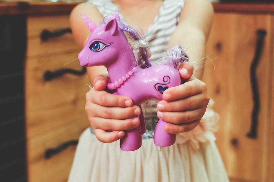 kaboompics.com_Child holding unicorn toy