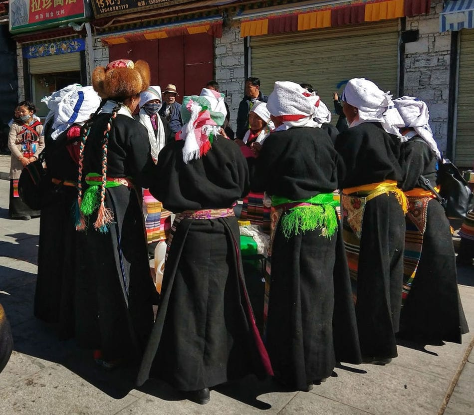 Women singing and dancing outside the Sera Monastery, before or after making their kora