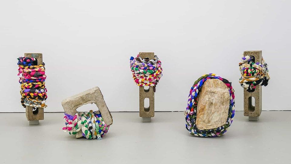 'Bundled Objects' -  repurposed braided fabric, found cinder blocks, quartz. Photo credit: Isaac Forsland.