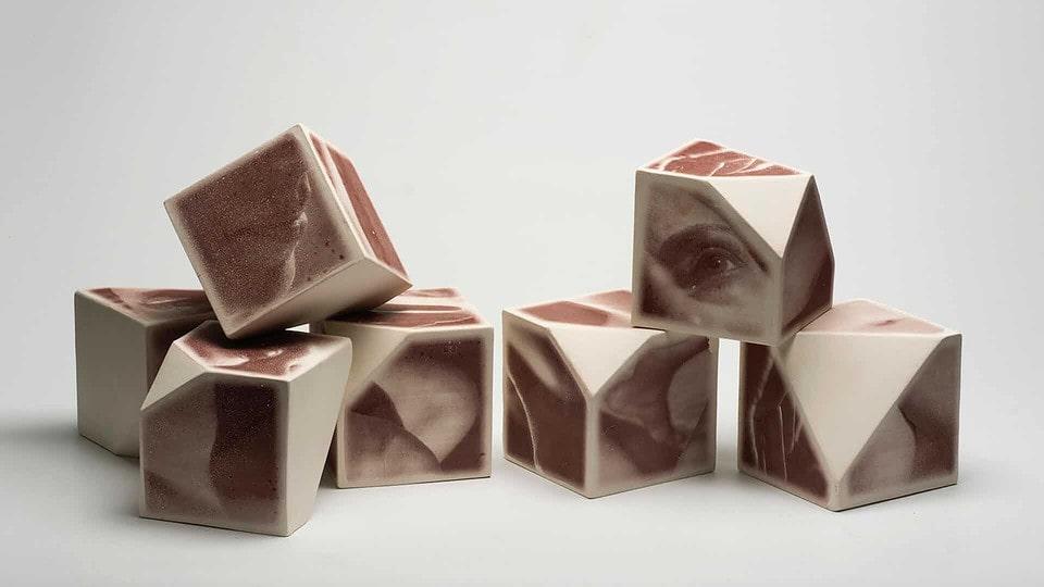 "Moving Forward, 11cm x 11cm x 11cm ""cubes"", porcelain/iron-oxide ceramic decal, 2015, photo credit: Dale Roddick."