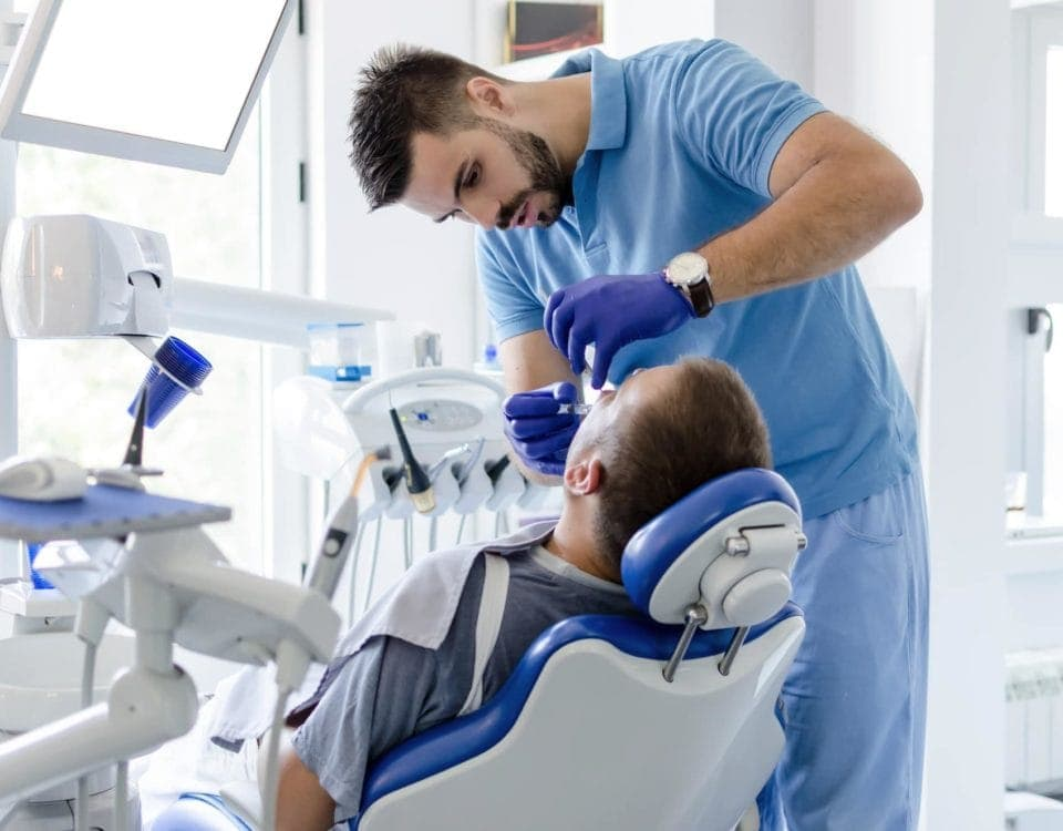 Dentist giving anesthesia to patient