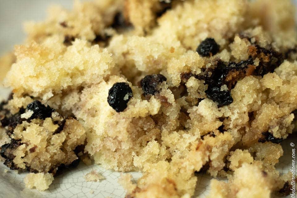 a serving of crockpot blueberry cobbler