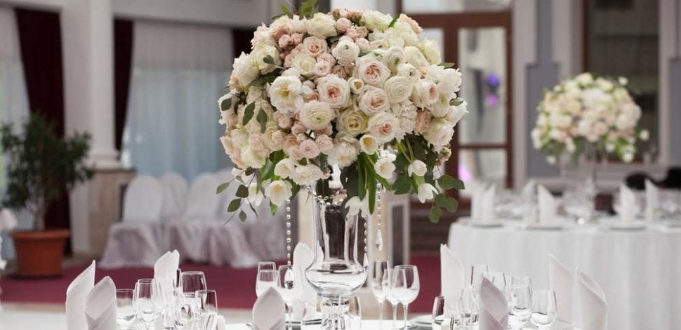 Extravagant floral centerpiece of ranunculus and garden roses
