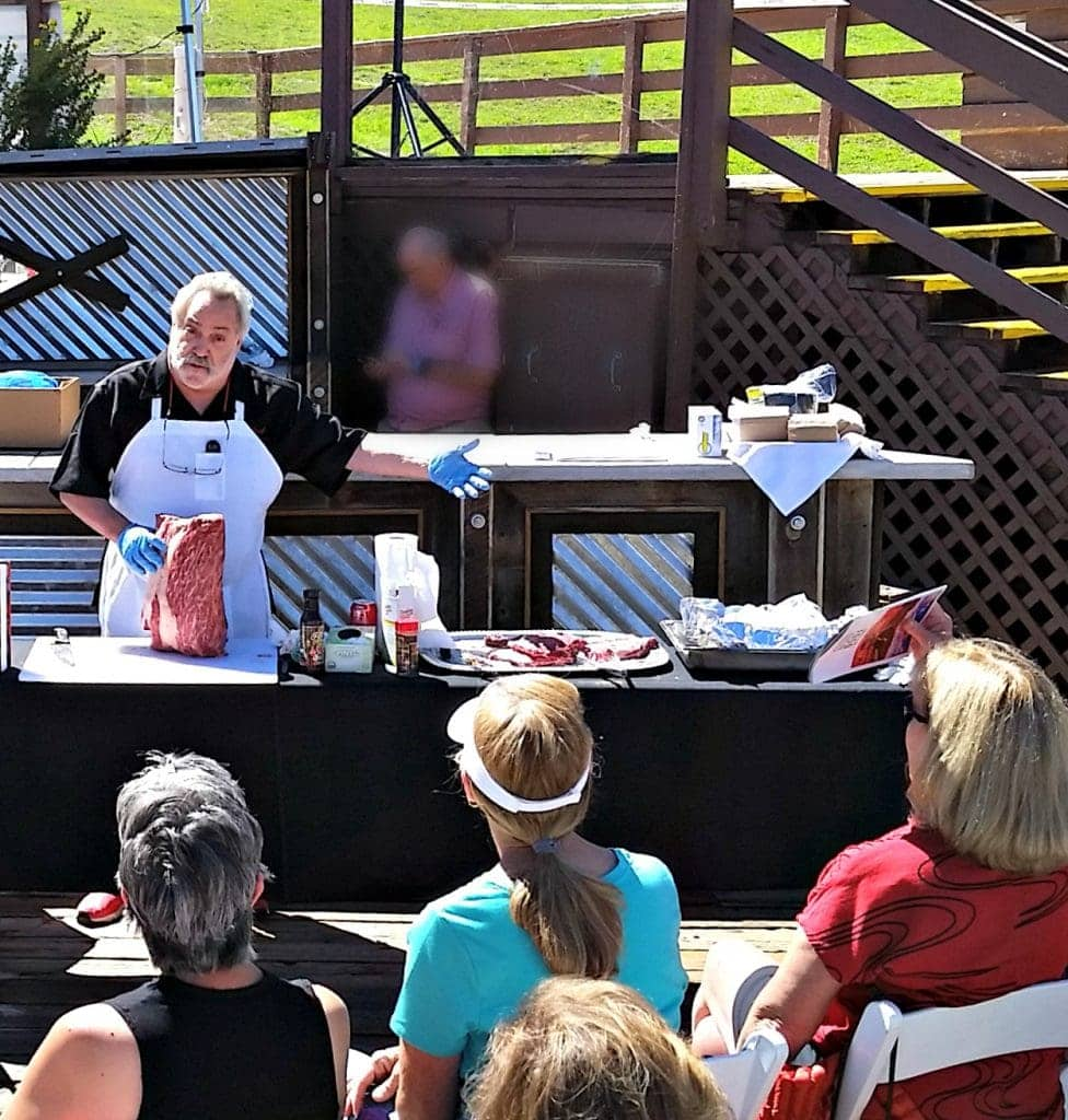 Meathead Goldwyn holds Texas Waygu Beef in front of outdoor audience