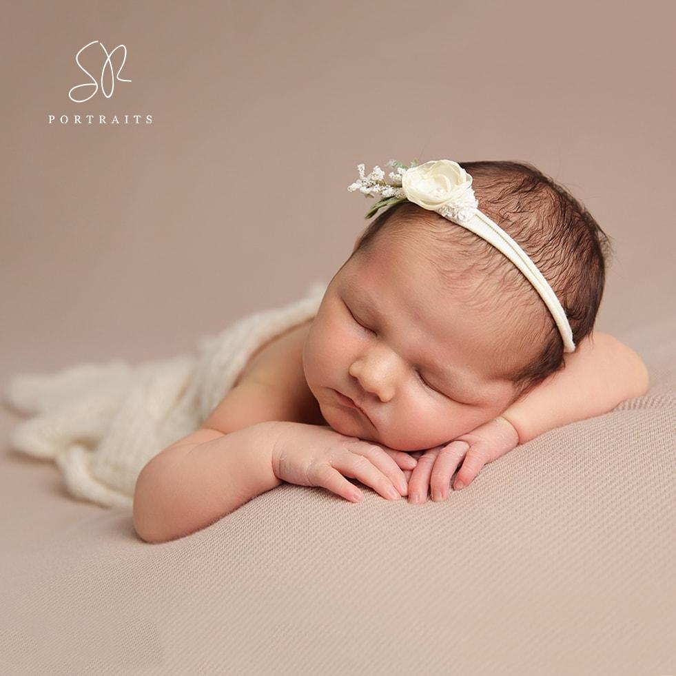 Newborn Girl on beige blanket with white headband SR Portraits