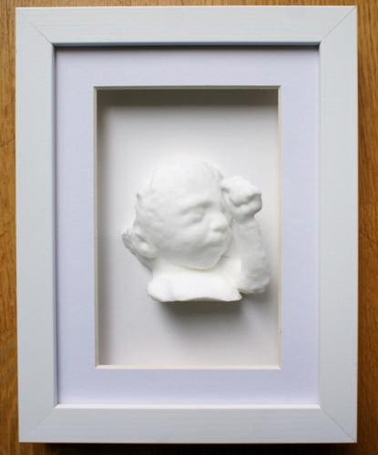 White Shadow box frame with statue 15 x 20