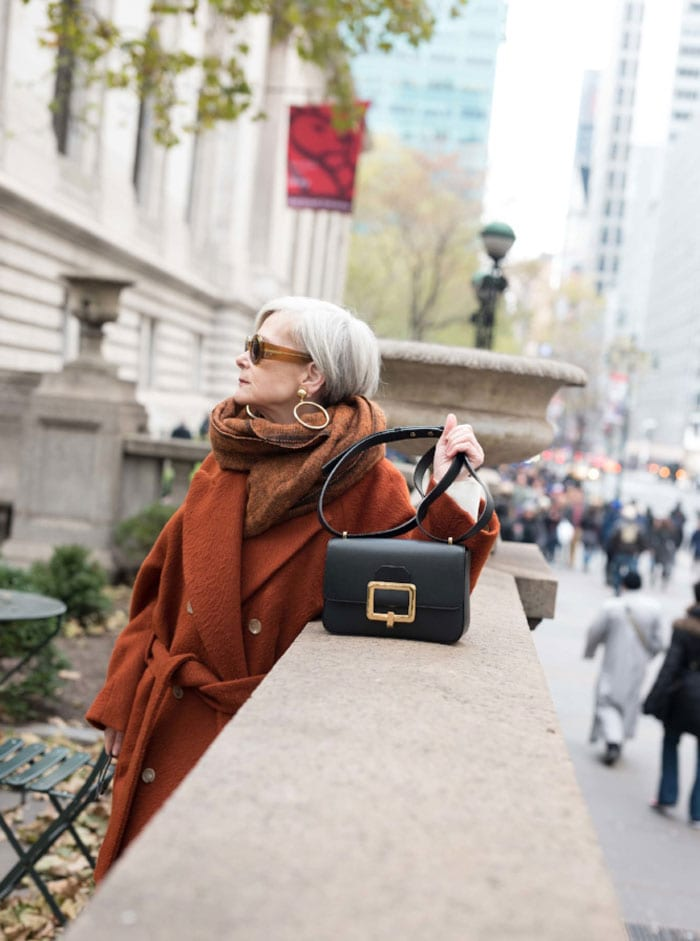 Accidental Icon Wearing Rust Trench Coat with Bag | 40plusstyle.com
