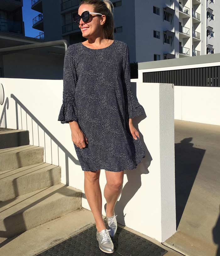 Bell sleeve dress and silver sneakers | 40plusstyle.com