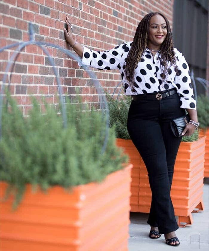 Work outfit idea: black jeans, polka dot print top and heels | 40plusstyle.com