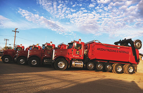Arizona Trucking & Materials offers large truck rentals to move your rocks, sand, gravel and other landscaping materials. Our truck rental options range from flat bed trucks to large, 18-wheel, 25-ton dump trucks.