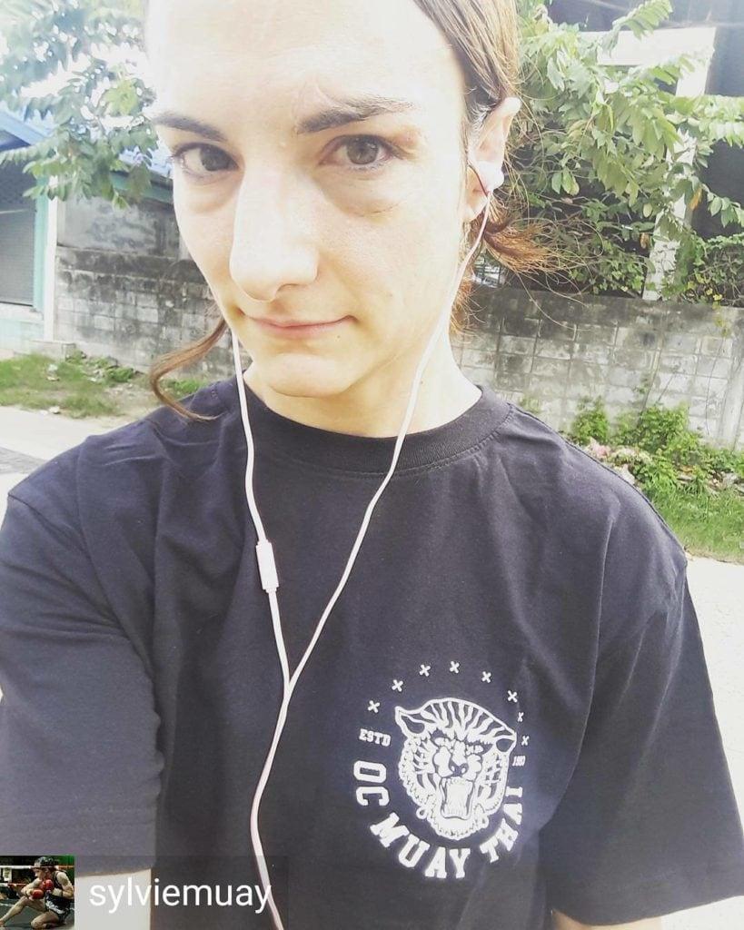 Sylvie a Muay Thai fighter wearing OC Muay Thai Tiger T-shirt