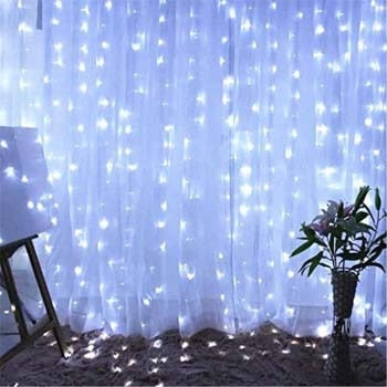 6. Twinkle Star 600 LED Window Curtain String Light