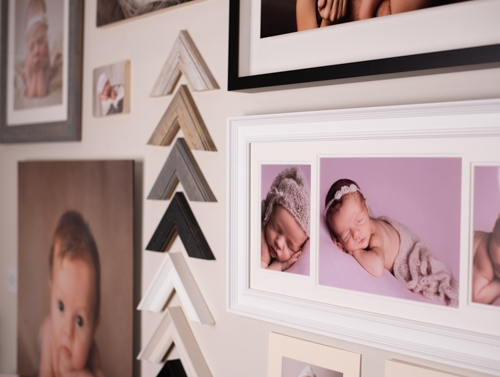 Wall of sample prints and frames