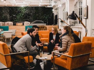 Community startup team talking in the Factory Berlin Görlitzer Park Cafe.