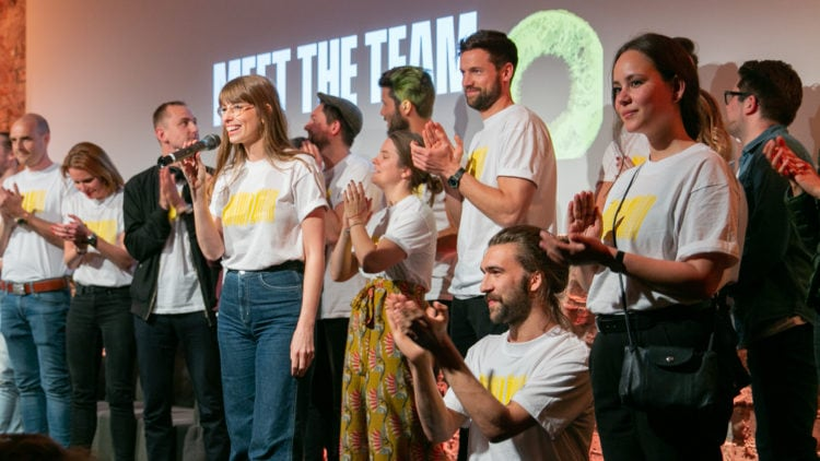 Team on stage at the Community All-Hands event