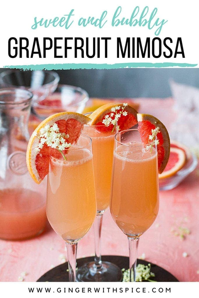 Three champagne flutes with grapefruit mimosa and text overlay at the top. Pinterest pin.