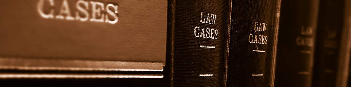 Image of law books representing the insurmountable amount of legal information that a person would normally have to search through when they have legal questions; however, Harwood Legal provides easy-to-understand answers in its legal resources for Southern WV.