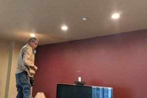 frank with honest lee handyman services in sacramento upgrading light fixtures in home to canned lighting