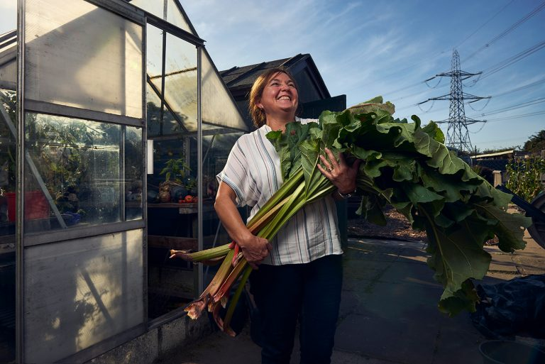 Caz - Holding the last crop of rhubarb from her allotment in Rossington, South Yorkshire.