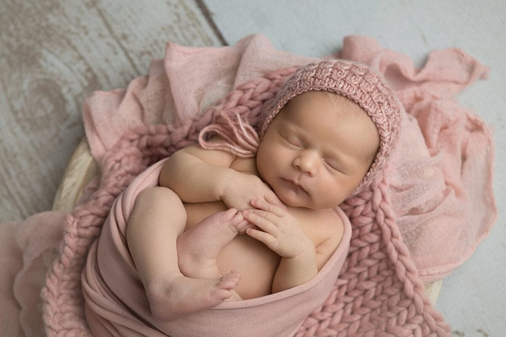 baby girl newborn wrapped in pink