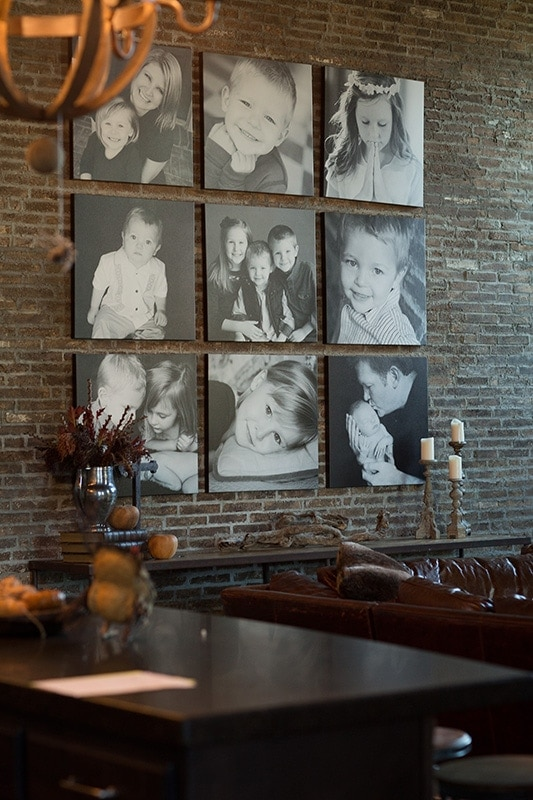 canvas wall of photos brick with nine portraits