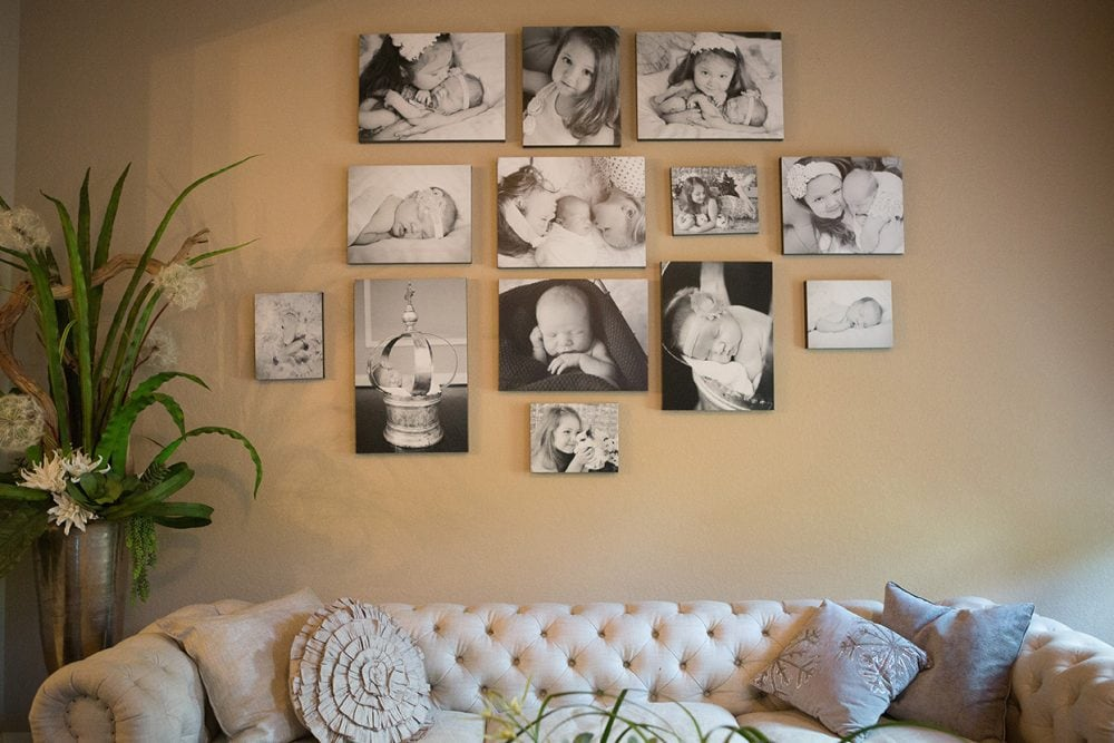 wall of black and white canvases family baby and children in prints