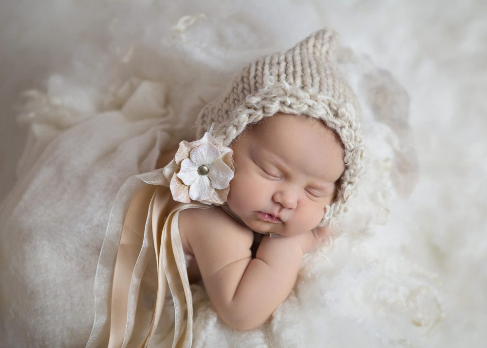 newborn in peach and cream flower