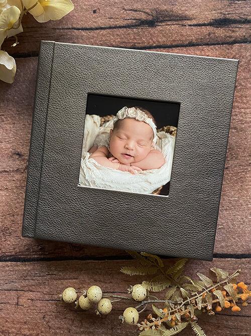 album of newborn images photogrpaher