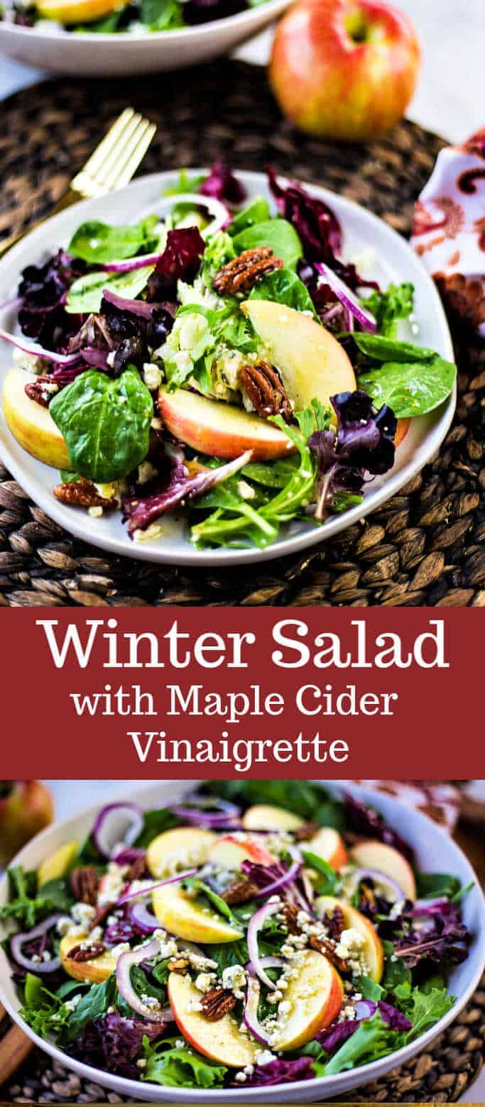 Winter Salad with Maple Cider Vinaigrette features crisp apples, red onion, and blue cheese crumbled all tossed together with salad greens and sprinkled with homemade candied pecans.