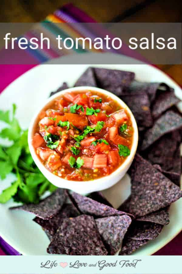 Make your own Fresh Tomato Salsa at home in just 10 minutes! Use my quick and easy recipe to blend together fresh ingredients, then serve this zesty salsa dip with your favorite tortilla chips or on top of tacos or burritos.