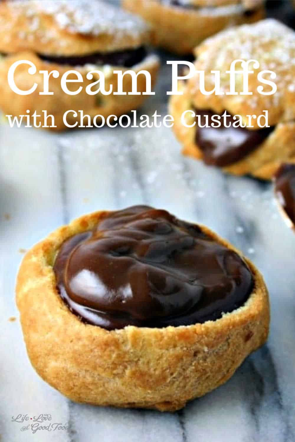 A decadent French pâte à choux (pastry shaped like a cabbage) or simply Cream Puffs with Chocolate Custard! Light and airy, these chocolate-filled cream puffs are creamy and delicious
