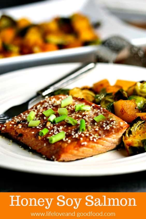 Honey Soy Salmon Sheet Pan Dinner. A flavorful weeknight meal of Asian-inspired sweet, flaky salmon with crisp roasted Brussel sprouts and butternut squash. You'll love this good-for-you, easy-to-prepare 30-minute recipe! #salmon #sheetpandinner