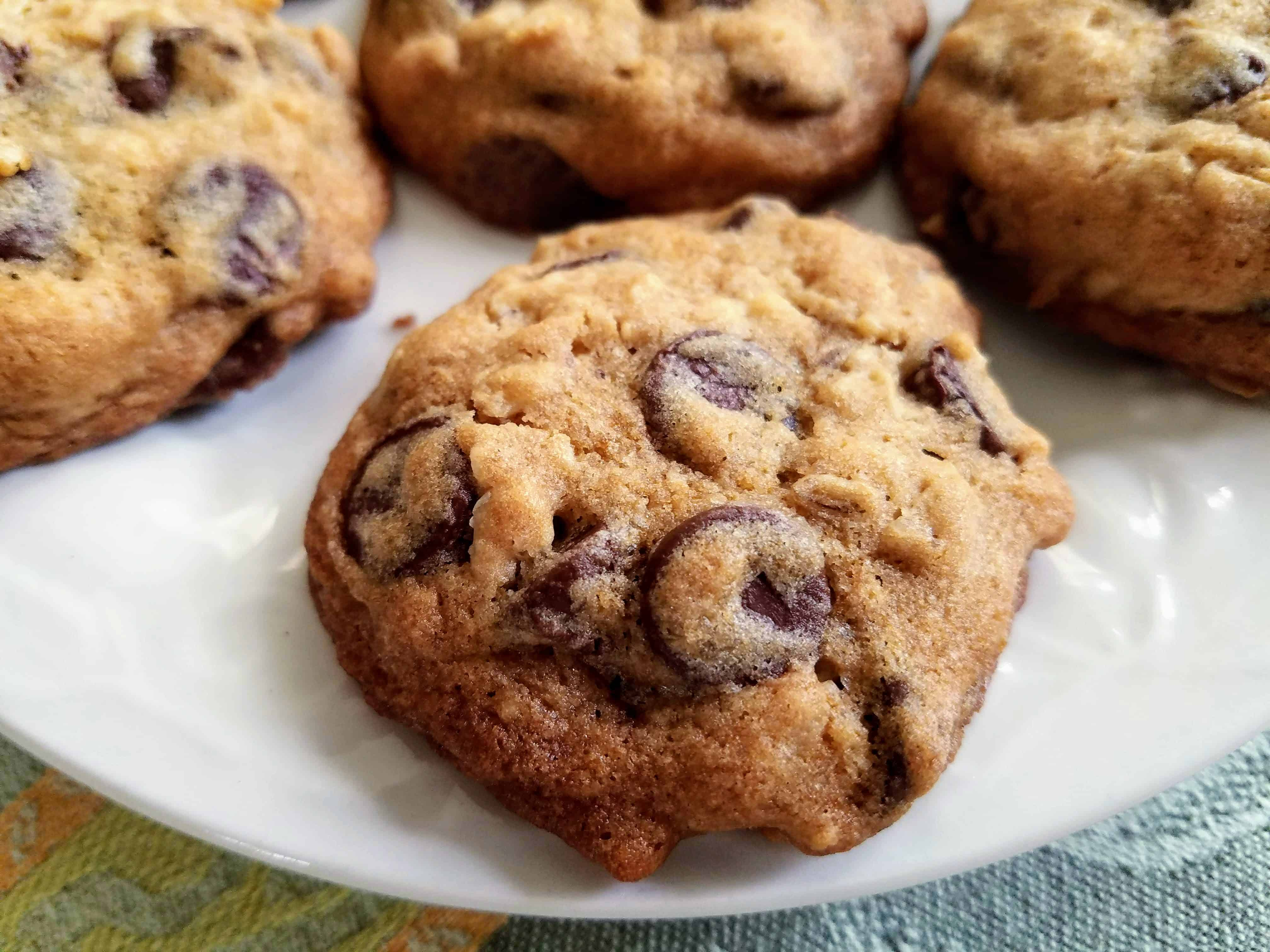 Soft and Chewy Oatmeal Chocolate Cookies will be your new favorite cookie! Packed with oatmeal and chocolate chips in every bite, it's the best chewy cookie ever! #BakeBetterCookies #CollectiveBias #ChewyChocolateChipCookies via @Mooreorlesscook
