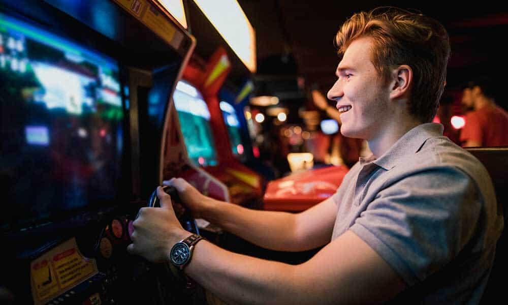 man playing arcade game