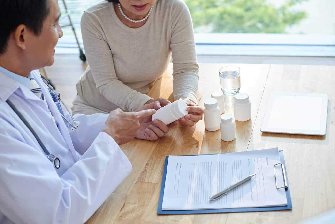 psychiatrist reviewing prescription pills