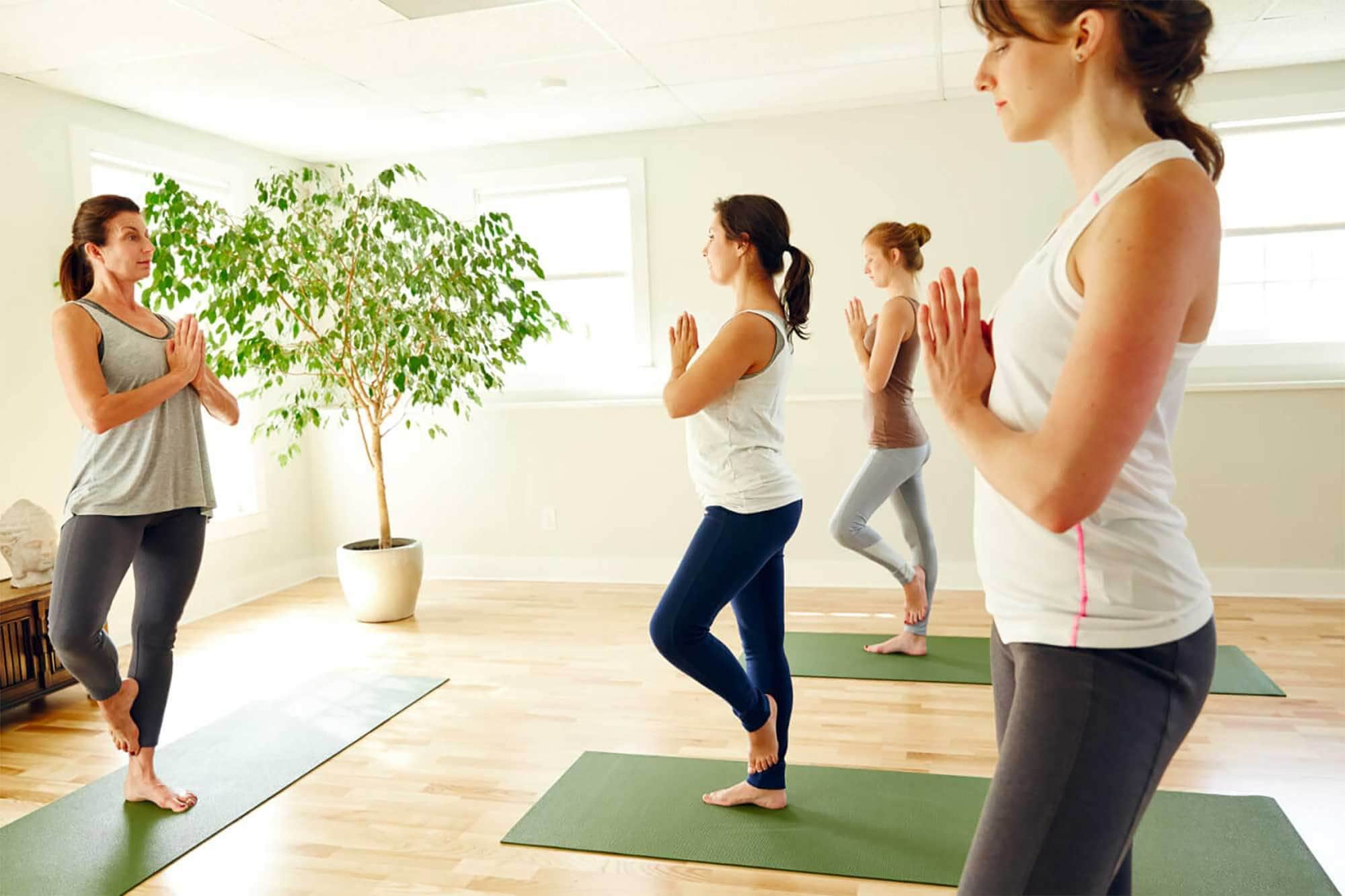 Women recovering from drug and alcohol addiction taking a yoga class at Mountainside rehab center