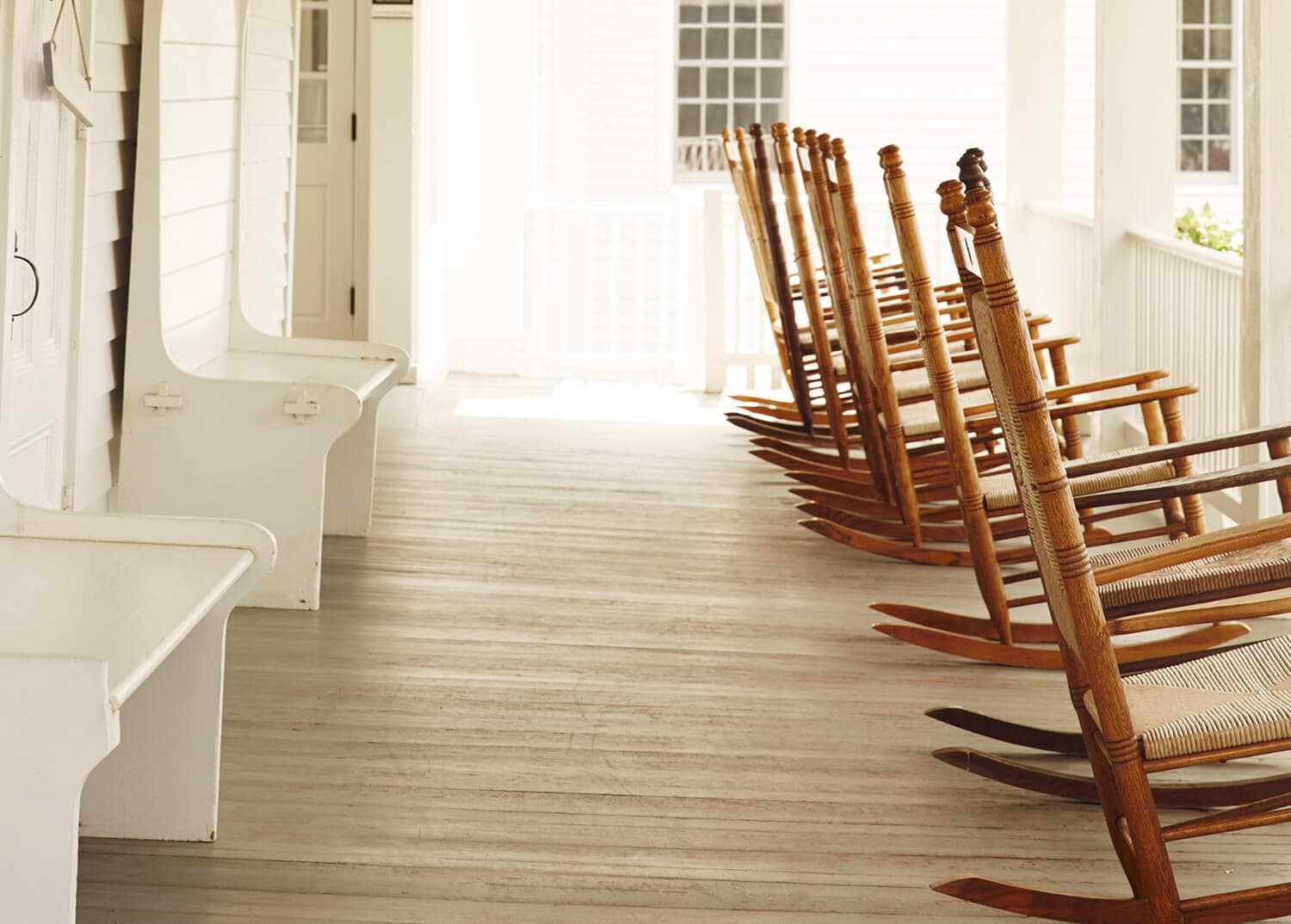 Porch at Mountainside Treatment Center chapel, lined with beautiful wooden rocking chairs- Canaan, Connecticut.