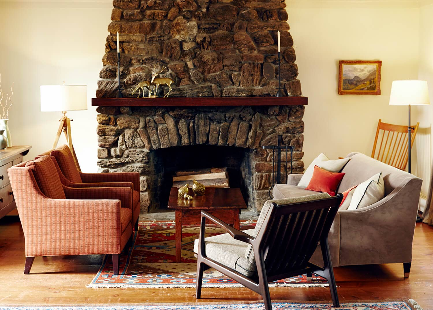 Comfortable lounge area with stone fireplace at Mountainside Addiction Treatment Center.