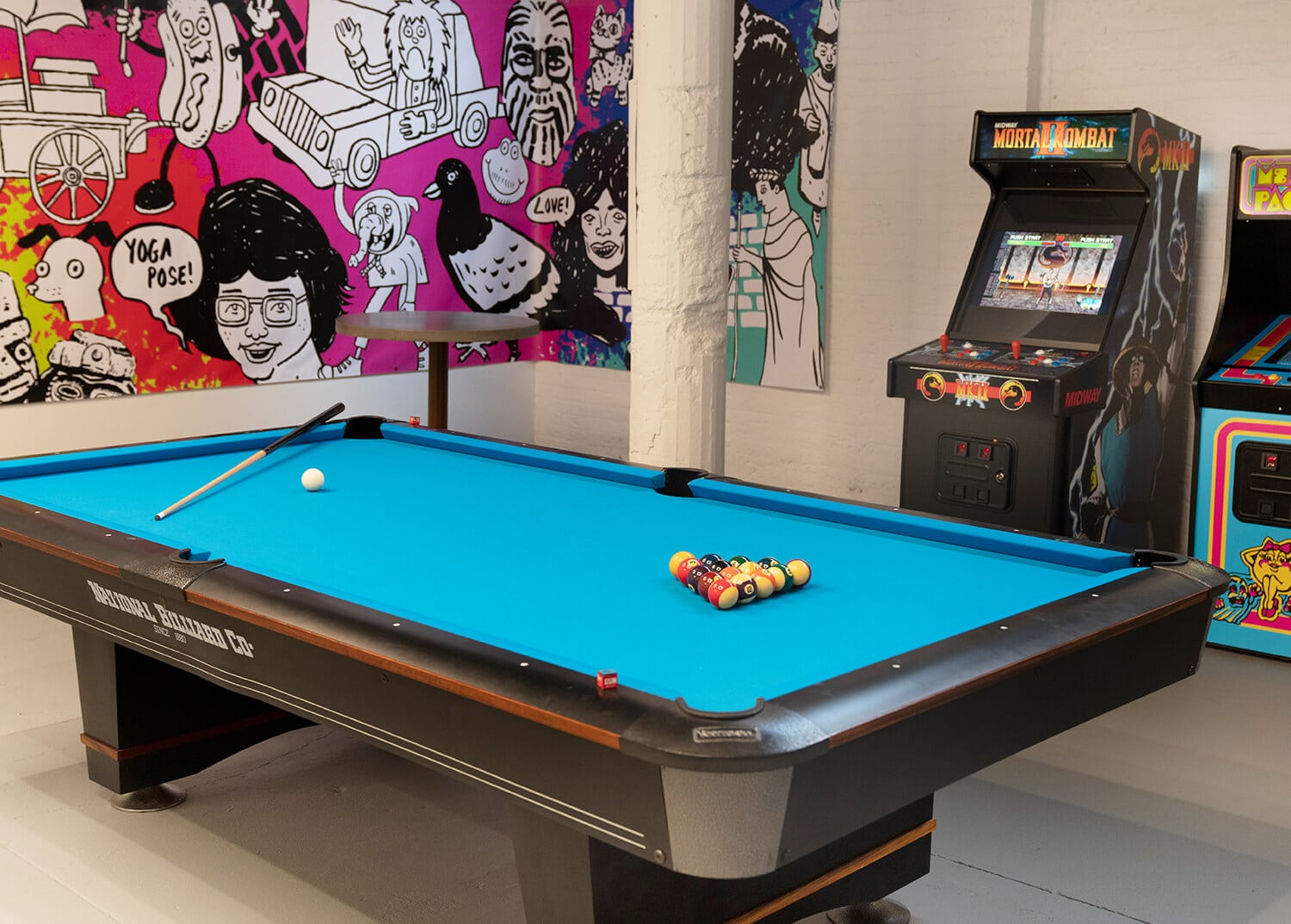 A pool table and arcade games at Mountainside Addiction Treatment Center, Chelsea NYC.